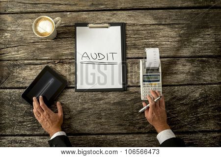 Top View Of An Auditor Making Calculations