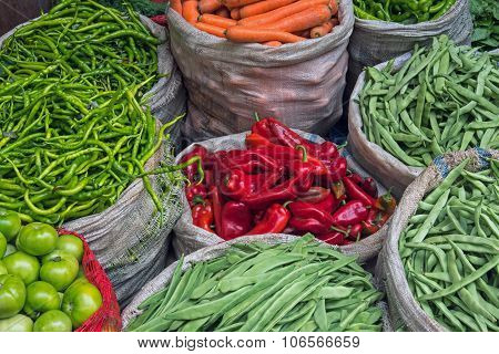 Bags full of vegetables at a market