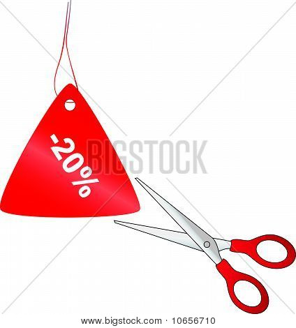 Scissors cutting red price tag