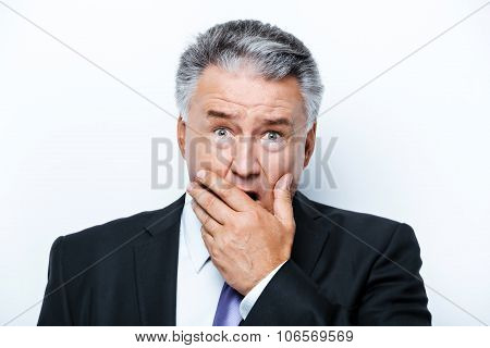 Concept for aged businessman on white background