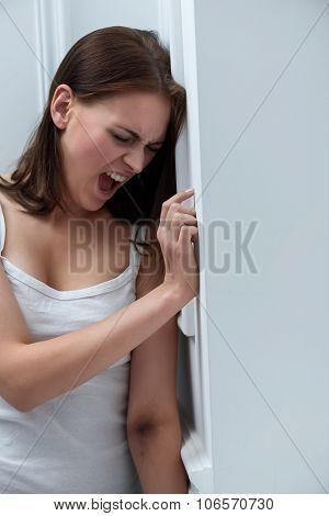 Depressed girl screaming