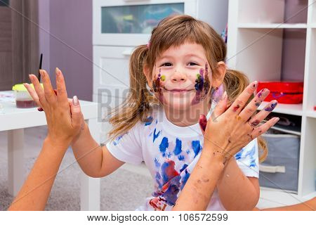 Little Girl Playing With Her Mother.