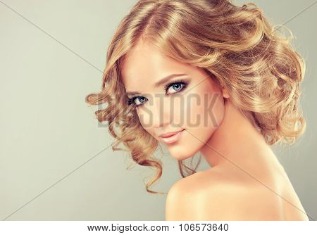 Pretty blonde girl with hairstyle  curled hair .Hairstyle medium length .
