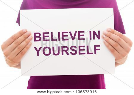 Girl holding white paper sheet with text Believe in yourself poster
