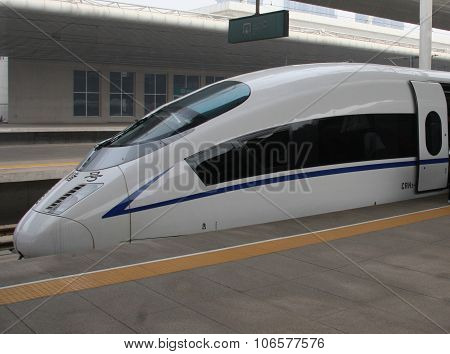 Chinese bullet train side view on Tianjin platform