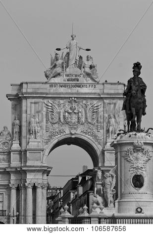 Architectural close up of the equestrian Statue of King Joseph and Rua Augusta Arch in Commerce square in Lisbon poster