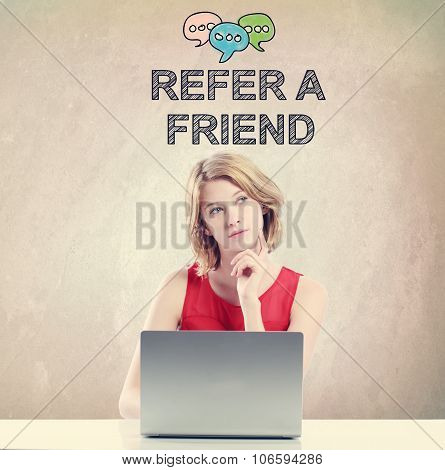 Refer A Friend Concept With Woman Working On A Laptop