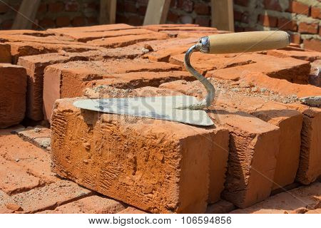 Stainless Trowel construction tool on the brick red located poster