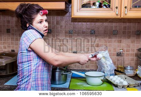 Woman In The Kitchen Talking On The Phone
