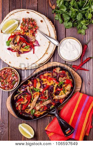 Pork Fajitas With Onions And Colored Pepper, Served With Tortillas,salsa And Sour Cream.