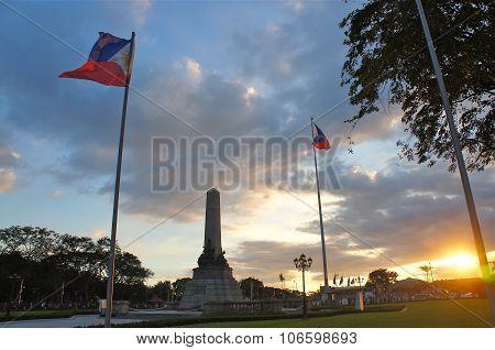 Manila, Philippines - Circa December 2014: Filipino Flag & Monument at Rizal Park at sunset in Manila, Philippines