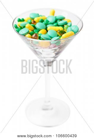 Vitamins in the glass, isolated on white. Healthcare concept.