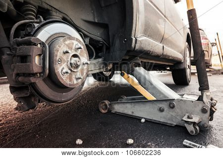 Replacing Wheels On A Car, Jack Holds The Body