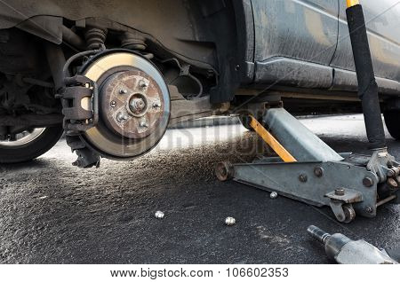 Replacing Wheel On A Car, Jack Holds The Body