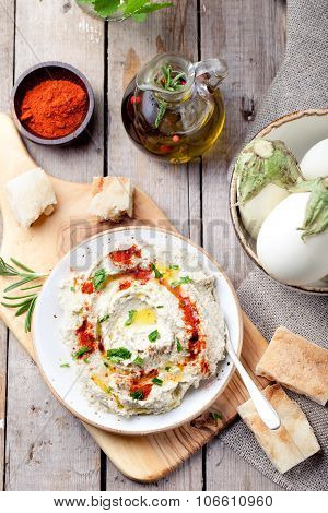 Traditional arabian eggplant dip baba ganoush with herbs, smoked paprika