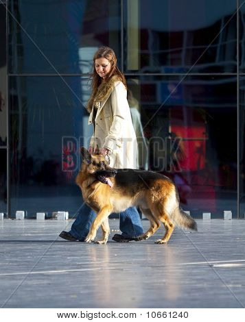 Woman walking her German Shepherd.