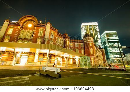 Traffic light in front of Public Tokyo train station. Night view of Public place, Tokyo Train Statio