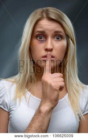 Beaten girl keeping silence