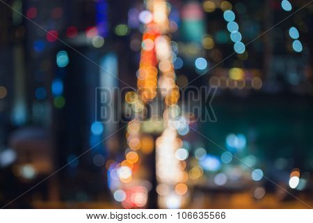 Blurred bokeh lights city road during busy hour