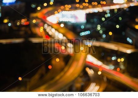 Abstract blurred bokeh lights, close up city highway intersection night view