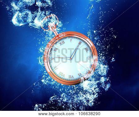Pocket watch sink in clear blue water