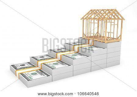 Real Estate Business Concept. House Frame Over Money Stack
