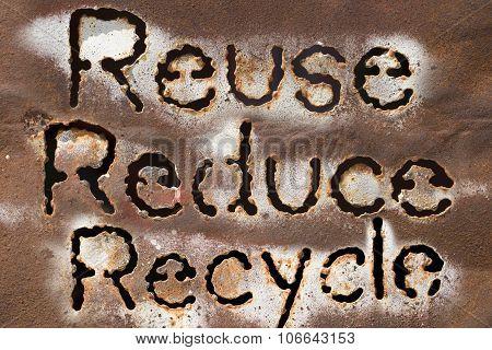 Reuse, Reduce, Recycle Word On Rust Metal Texture
