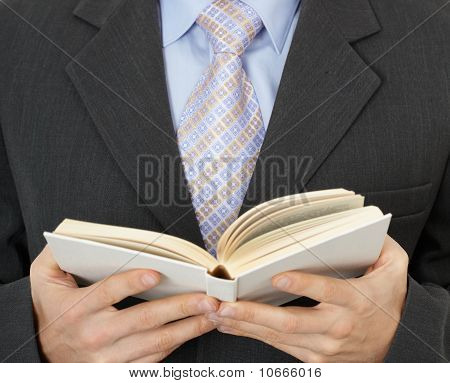 Businessman Reading Statute Book
