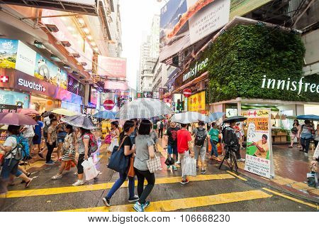 Many People In Mongkok Street In Rainy Day