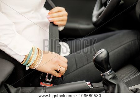 Woman buckling up