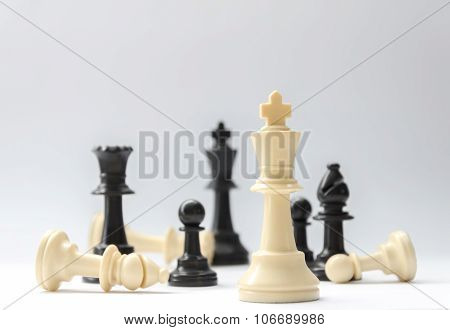 chess battle - plastic chess pieces, selective focus