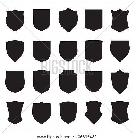 Shield icons set. Different black shield shapes. Vector illustration.