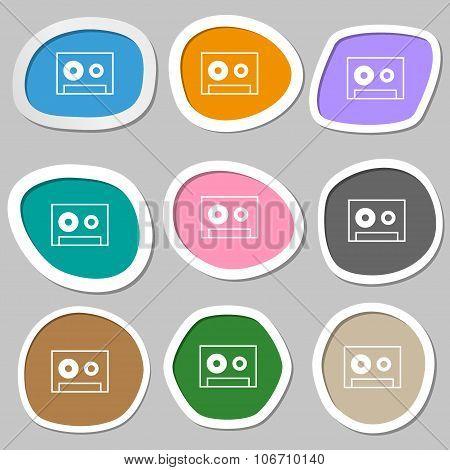 Cassette Sign Icon. Audiocassette Symbol. Multicolored Paper Stickers. Vector