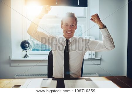Business Man Holding Arms Over Head