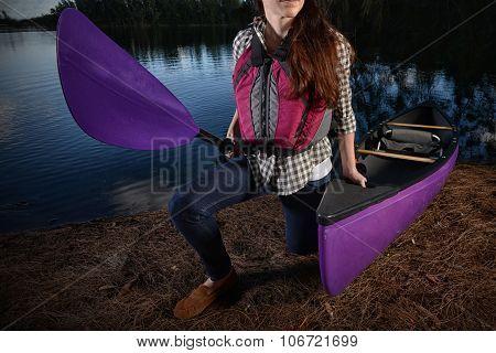 Woman And Kayak At Lake In The Fall