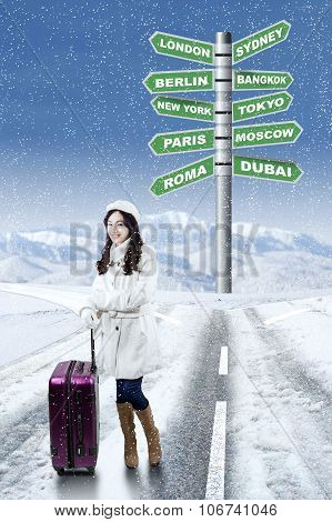 Woman With Winter Destination Vacation Choices