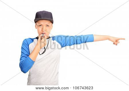 Female baseball referee blowing a whistle and pointing with her hand to the right isolated on white background