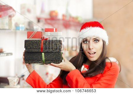 Surprised Christmas Girl with Presents in Gift Shop