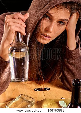 Drunk girl drinking of bottle of alcohol. Soccial issue female alcoholism. poster