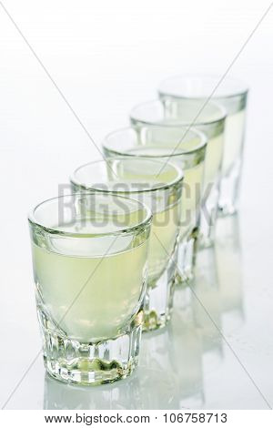 Beautiful shot glasses back lit. yellow