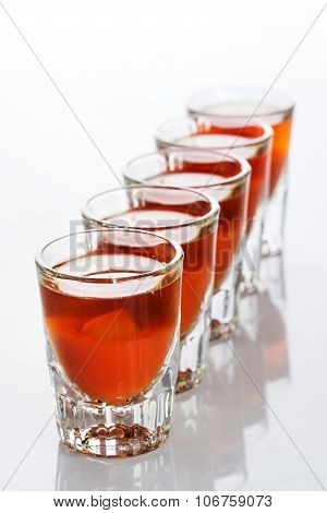 Beautiful shot glasses back lit. red