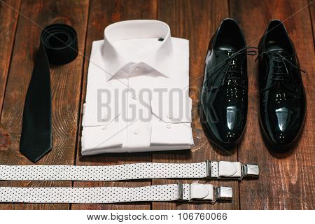 Black Tie , Patent Leather Shoes , Suspenders, A White Shirt