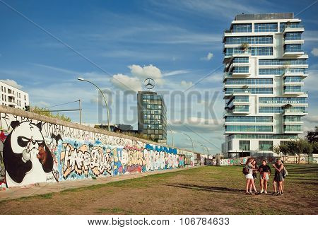 Young Girls Walking Around Funny Artworks Of Outdoor East Side Gallery