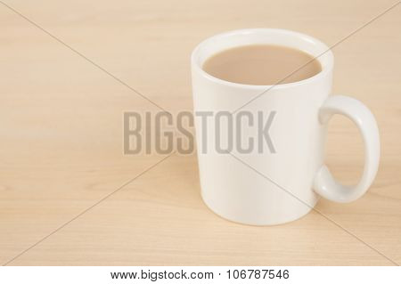 Mug Of Tea On Wooden Table