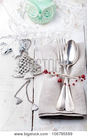 Christmas and New year table place setting with decorations.