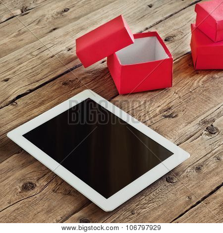 Tablet Computer With Gifts And A Cup Of Coffee
