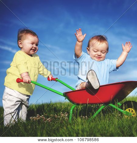 Babies Toddlers Enjoyment Fun Playing Concept poster