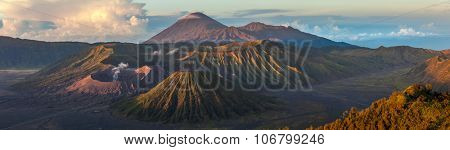 Panorama of the group of volcanoes in the National Park of Java island, Indonesia. Bromo (smoking), Batok, Semeru volcanoes