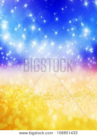 Abstract Christmas background with shiny stars in blue and gold color. New year lights, starry sky