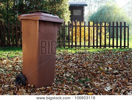 Garden With Brown Dustbin For Autumn Fallen Leaves